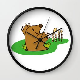 a Mole from the ground greets horsetail Wall Clock