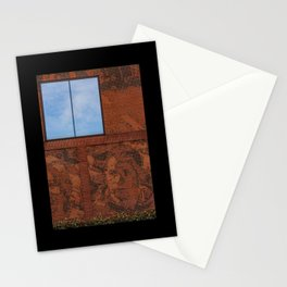 Building facade with a glass window on which a blue sky is reflected Stationery Cards