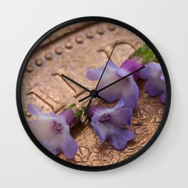 tiny flowers on a coin Wall Clock