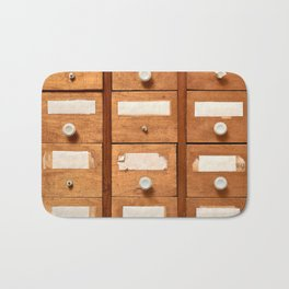 Backgrounds and textures: very old wooden cabinet with drawers Bath Mat