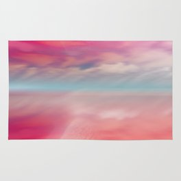 """Rose quartz sky on beach shore"" Rug"