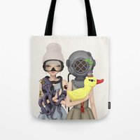diver Tote Bags featuring diver by Anne  Martwijit