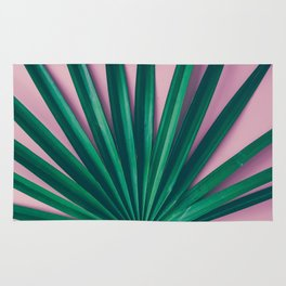 Tropical leaves on pastel pink background Rug