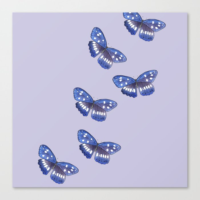 Blue butterflies on lilac background Canvas Print