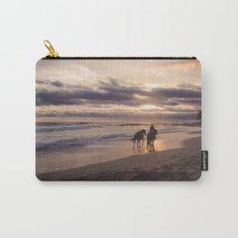 Man rides his horses along the shore of a paradise beach in Costa Rica at sunset Carry-All Pouch
