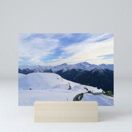 The snowy rocks at mountain tops Mini Art Print
