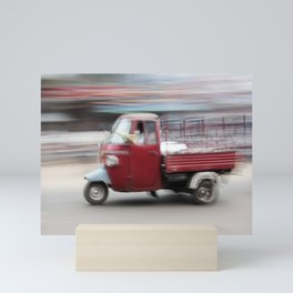 Red scooter drives on the streets in Orissa India   Long exposure travel photography Mini Art Print