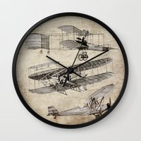airplanes Wall Clocks featuring airplanes by Кaterina Кalinich