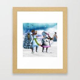 Funny, cute snowman and snow women Framed Art Print