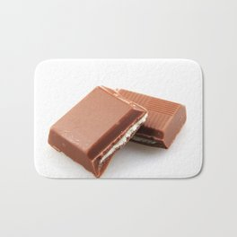 Chocolate Bar Against White Background Bath Mat