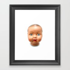 Dolls head Framed Art Print