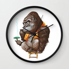A gorilla relaxing after taking bath Wall Clock