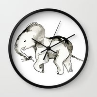 baby elephant Wall Clocks featuring Baby Elephant by @bylacey