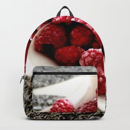 Raspberries on white serving bowl close up Backpack