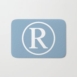 Registered Trademark Sign on placid blue background Bath Mat