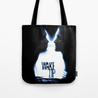 donnie darko Tote Bags featuring Wake up.....(Donnie Darko Fanart) by Emiliano Morciano (Ateyo)