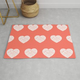 Romantic pattern with white hearts on coral background Rug