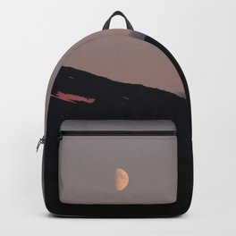 Moon over blackness and red pink ice Backpack