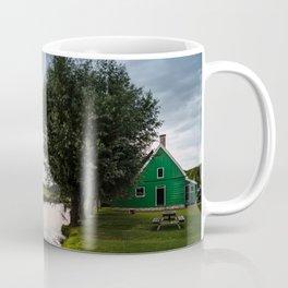 Green cottage at summer sunset Coffee Mug