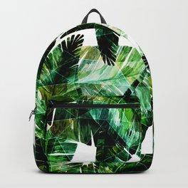 Green leaves of a banana. 2 Backpack