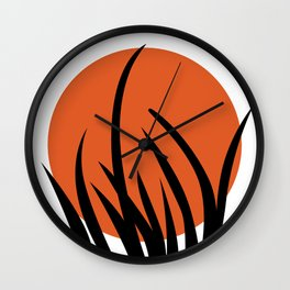 The sun and the grass Wall Clock