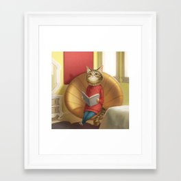 A cat reading a book Framed Art Print
