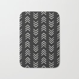 Charcoal & soft white brushed arrow heads, textured background Bath Mat