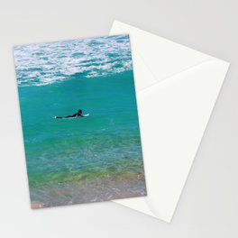 Surfer paddling to the surf at Bronte Beach. Sydney. Australia. Stationery Cards