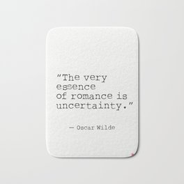 """The very essence of romance is uncertainty."" Oscar Wilde Bath Mat"