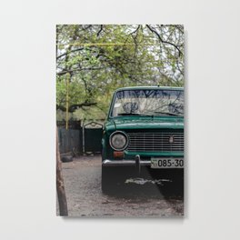 Retro car in the cloudy weather, in countryside yard. Metal Print