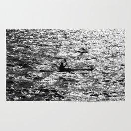 Man go on a kayak along the bay Rug