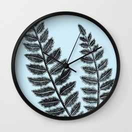 Black lace fern on powder blue background Wall Clock