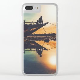 Kid sitting on a boat during the sunset Clear iPhone Case