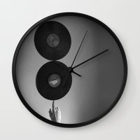 records Wall Clocks featuring Spinning Records by Skye Zambrana