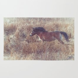 brown horse running in the fields Rug