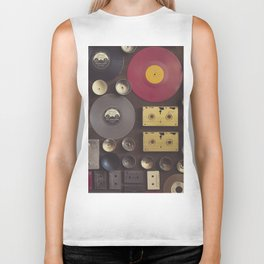Music. Vintage wall with vinyl records and audio cassettes hung. Biker Tank
