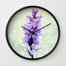 Teeny tiny lil orchids inhabitants Wall Clock