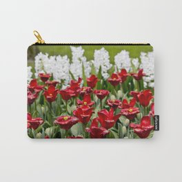 Red Tulip Field with White Hyacinth Flowers Blooming in the Background in Amsterdam, Netherlands Carry-All Pouch