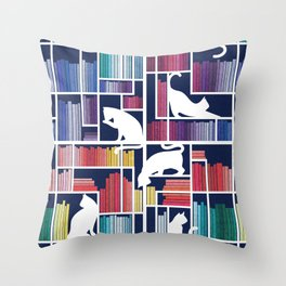 Rainbow bookshelf // navy blue background white shelf and library cats Throw Pillow
