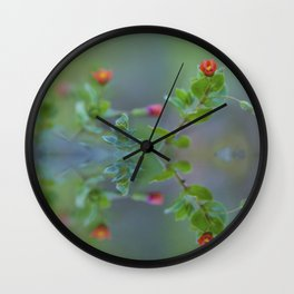 Reflection of little red wildflowers Wall Clock