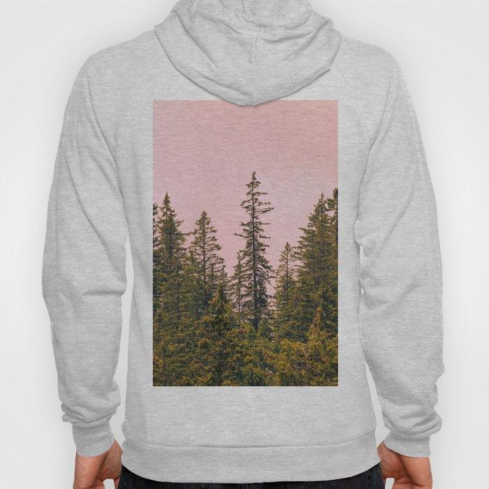 Tall trees against pink sky Hoody