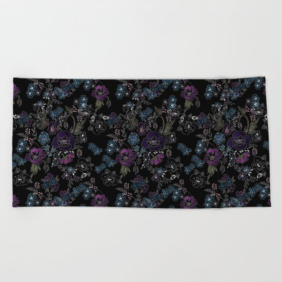 Floral pattern on a black background . Blue and purple flowers . Beach Towel