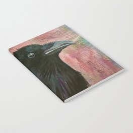 Raven rising against a pink sunset Notebook