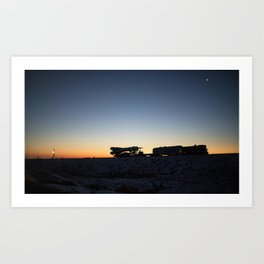 The Soyuz rocket is rolled out by train to the launch pad Dec 15 2017 at the Baikonur Cosmodrome in Art Print