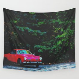 red classic car in the forest with green tree background Wall Tapestry