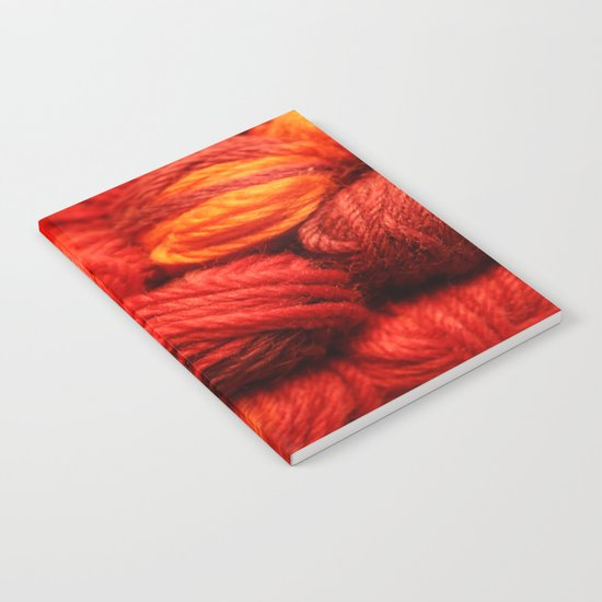 Many Balls of Wool in Shades of Red Notebook