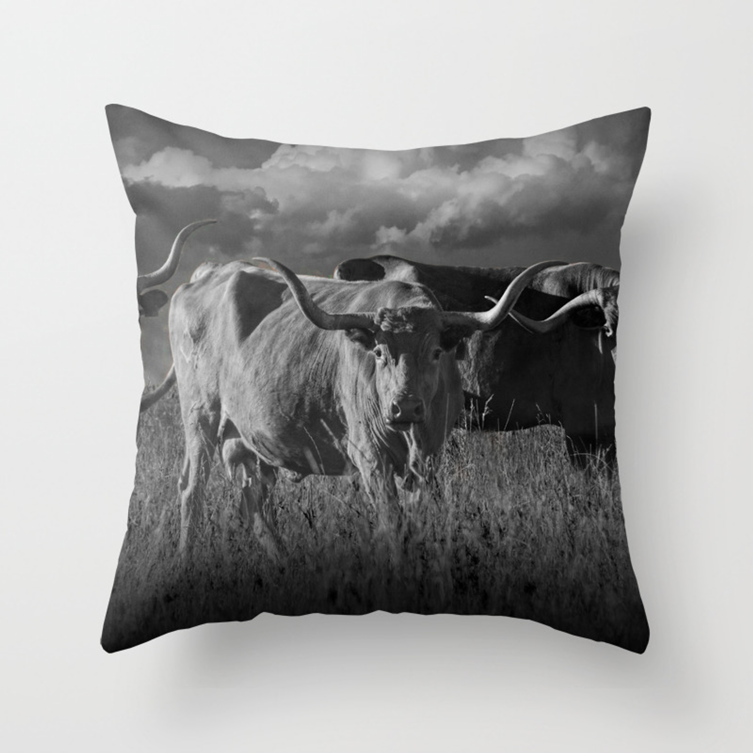 Texas longhorn steers under a cloudy sky in black white throw pillow
