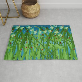 in the grass Rug