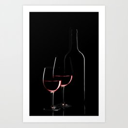 Red wine bottle and two wine glasses on black background on black background Art Print