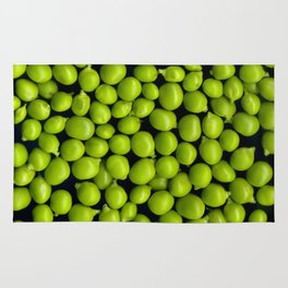 Texture and background of green peas on a black background Rug